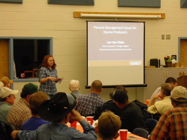 Amber Starnes of the Chesterfield Soil and Water Conservation District giving attendees information on the Hills Creek Water Quality Grant program.
